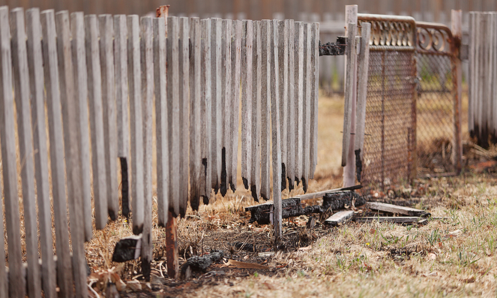 bushfire fence damaged stock image